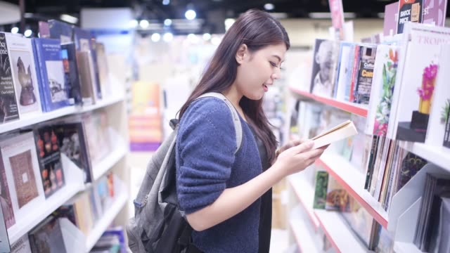 asian beautiful college student working in library - bookstore stock videos & royalty-free footage