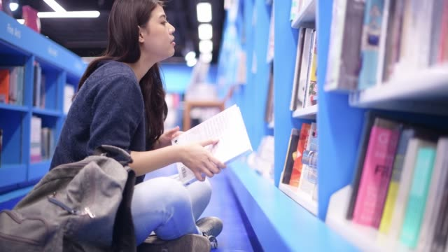 asian beautiful college student working in library - book shop stock videos & royalty-free footage