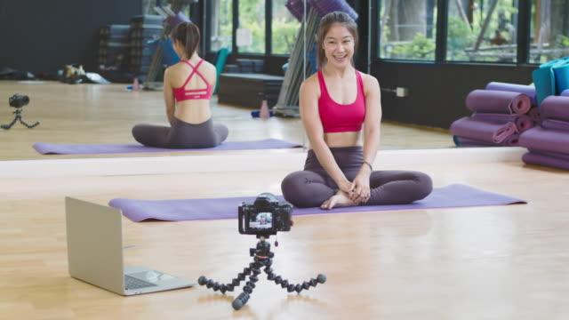 asian beautiful woman teaching yoga online - skill stock videos & royalty-free footage