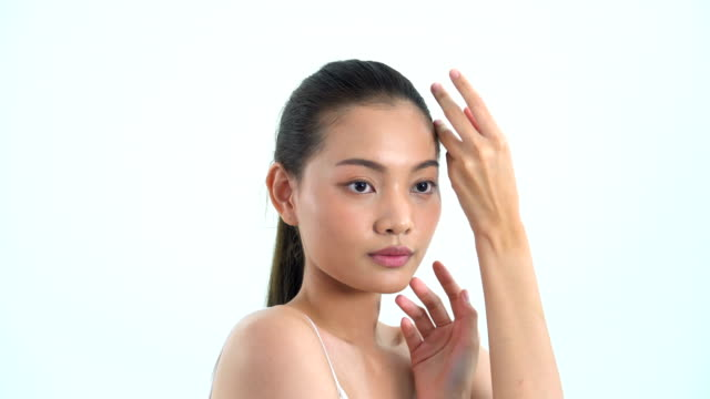 asian beautiful woman touching around all her face on white background. people with beauty, healthcare, emotion concept. - model object stock videos & royalty-free footage