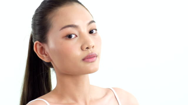 asian beautiful woman touching around her chin on white background. people with beauty, healthcare, emotion concept. - model object stock videos & royalty-free footage