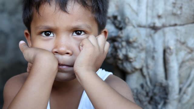 hd asian boy closeup - fattigkvarter bildbanksvideor och videomaterial från bakom kulisserna