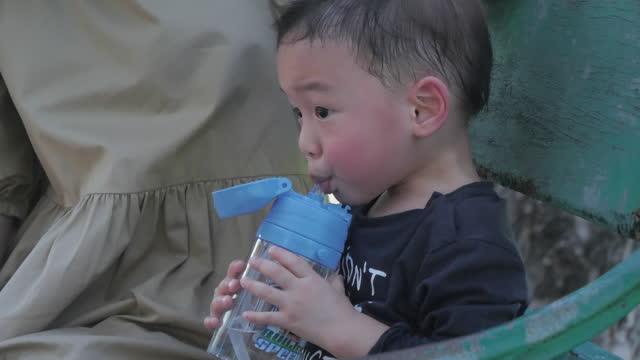 asian boy drinking water after he play - 2 3 years stock videos & royalty-free footage