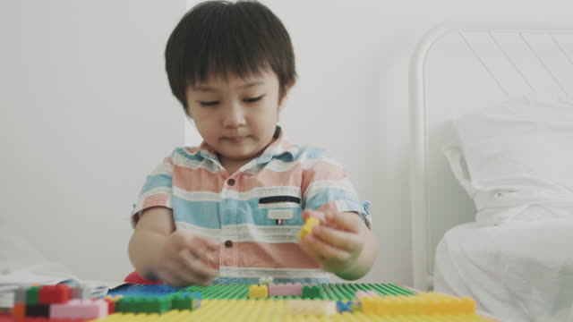 asian boy is playing toy block - baby boys stock videos and b-roll footage