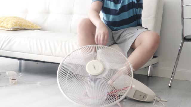 asian boy learning how to assembly electric fan at home, lifestyle concept. - learning disability services stock videos & royalty-free footage