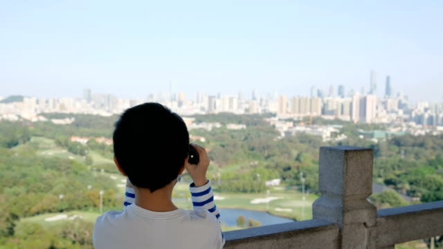 asian boy looking with binoculars - binoculars stock videos & royalty-free footage