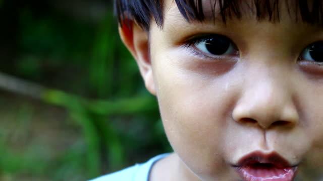 asian boy making faces