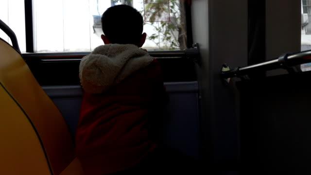 asian boy sitting in bus - schoolboy stock videos & royalty-free footage
