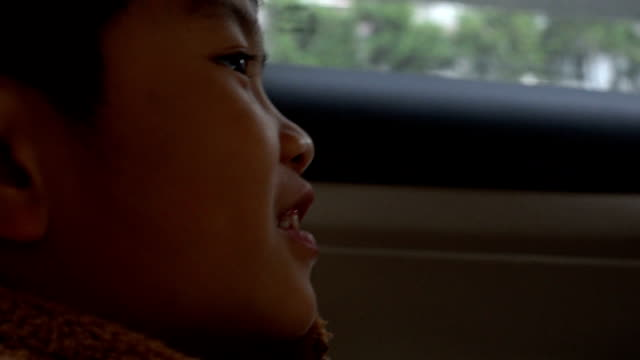 asian boy sitting in car - land vehicle stock videos & royalty-free footage