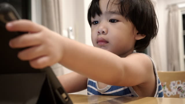 asian boy using digital tablet - electronic book stock videos & royalty-free footage