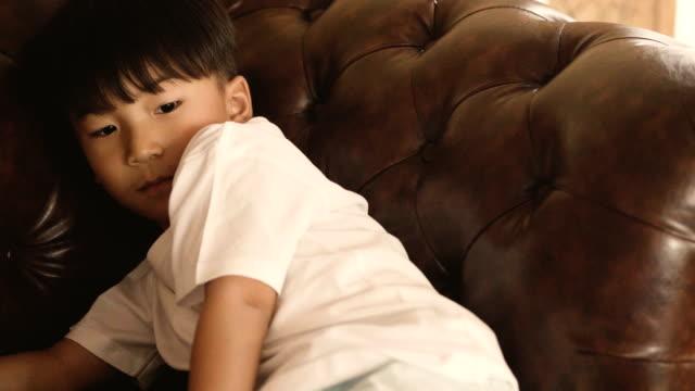 asian boy - boredom stock videos & royalty-free footage