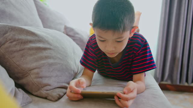 asian boy watching live streaming casting games on social media. - digital native stock videos & royalty-free footage