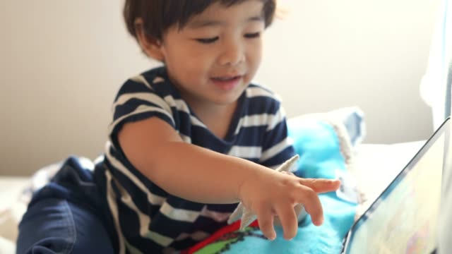 asian boy watching tablet - electronic book stock videos & royalty-free footage