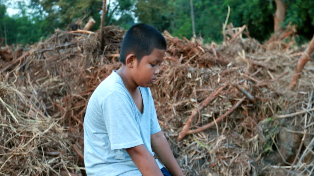 asian boy who suffer from natural disasters with a sad face - school yard stock videos & royalty-free footage