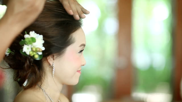 asian bride having hairdo on her wedding day - bride stock videos and b-roll footage