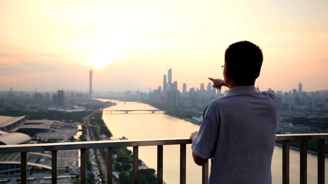 Asian Business Man Introduce Guangzhou CBD