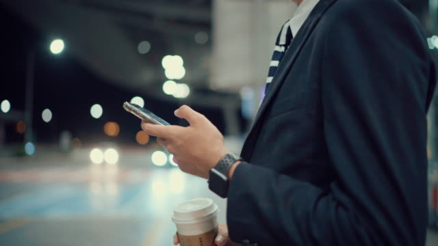 asian business man using smartphone for waiting taxi or uber, night - full suit stock videos & royalty-free footage