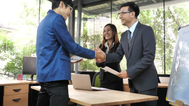 Asian Business people agreement a Business project, Handshake
