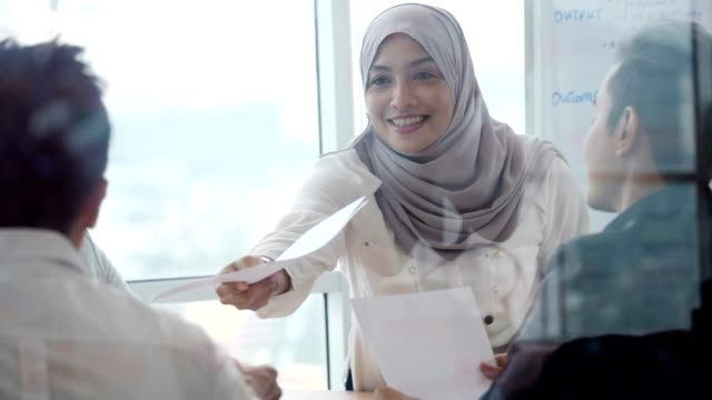 asian business people attend meeting in board room - malaysia stock videos & royalty-free footage