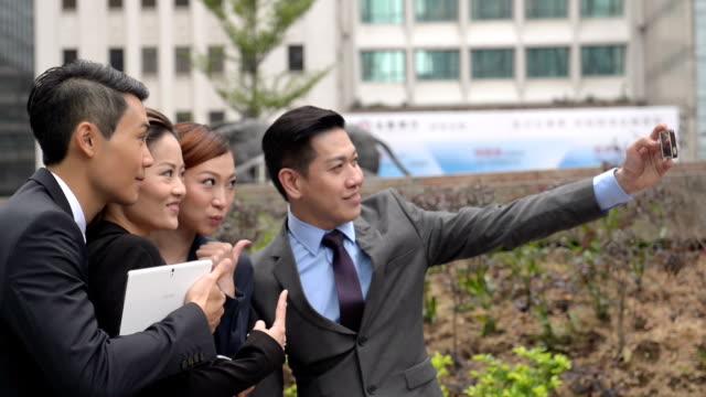 Asian Business People Taking Selfie
