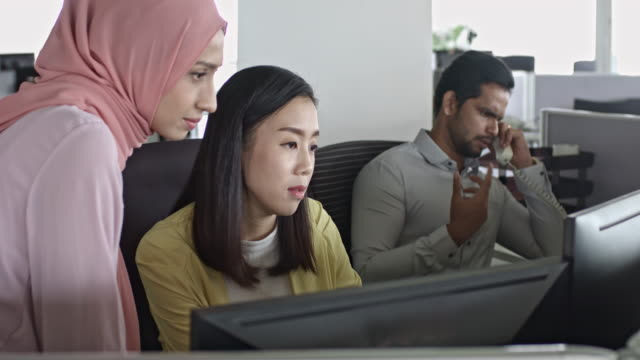 Asian business people working at office