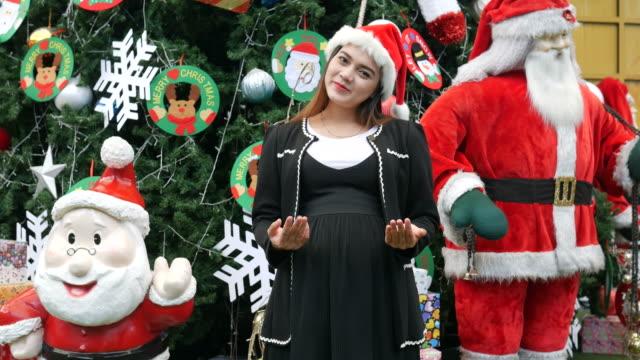 Asiengeschäft schwanger, Weihnachtszeit, Willkommens-Schild