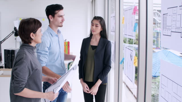 asian business team discussing business in office.creative business team brainstorming ideas working together sharing data late at day after hours in modern glass office - casual clothing stock videos & royalty-free footage