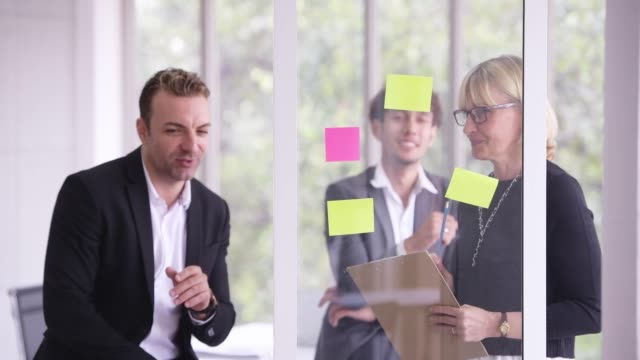 asian business team planning business strategy with adhesive note - agility stock videos & royalty-free footage