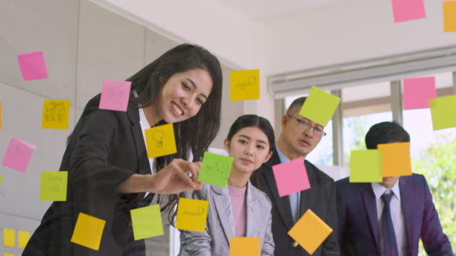 asian business team share idea on plastic board - sticky stock videos and b-roll footage