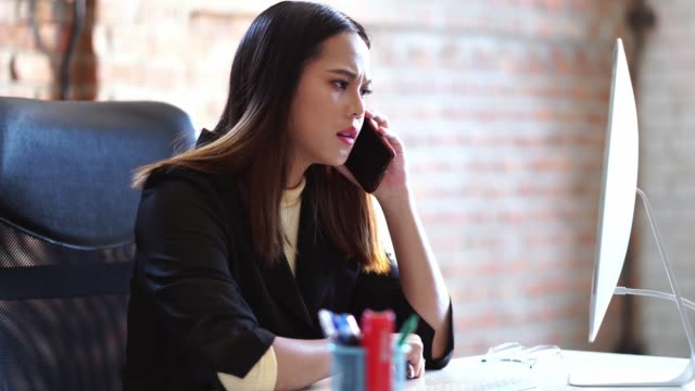 asian business woman she is stressed from coordination. - frustration asian failure stock videos & royalty-free footage