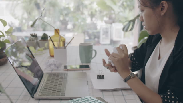 asian business woman work from home with laptop on table writing and crumple paper and throw away..concept of social distancing to stop the spread disease of corona virus.4k uhd.slow motion. - terrified stock videos & royalty-free footage