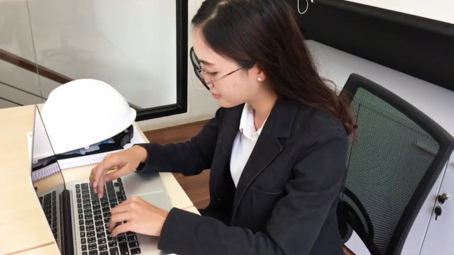 Asian business women using notebook and typing for working,slow motion