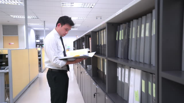 Asian businessman are searching for an information form files folders