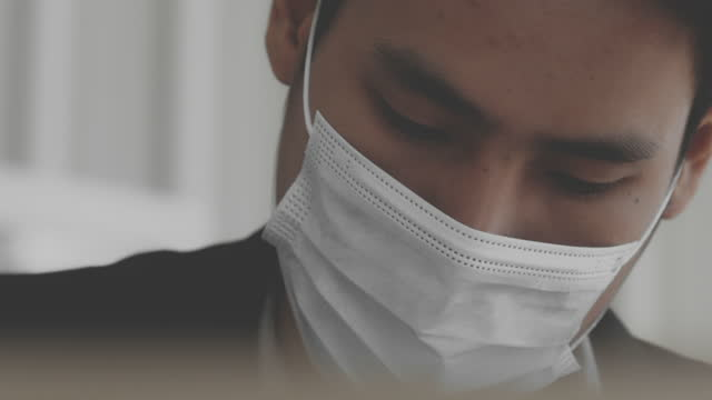 2021 asian businessman , coronavirus , covid-19 effect - formal businesswear stock videos & royalty-free footage