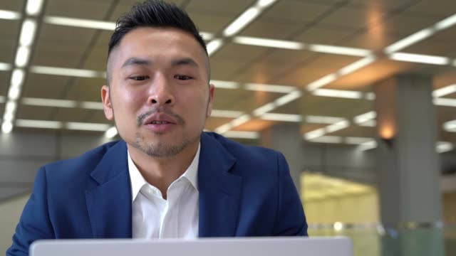 asian businessman having video conference with customer - businesswear stock videos & royalty-free footage