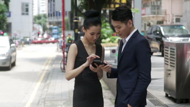 asian businesspeople with a smartphone - business relationship stock videos & royalty-free footage
