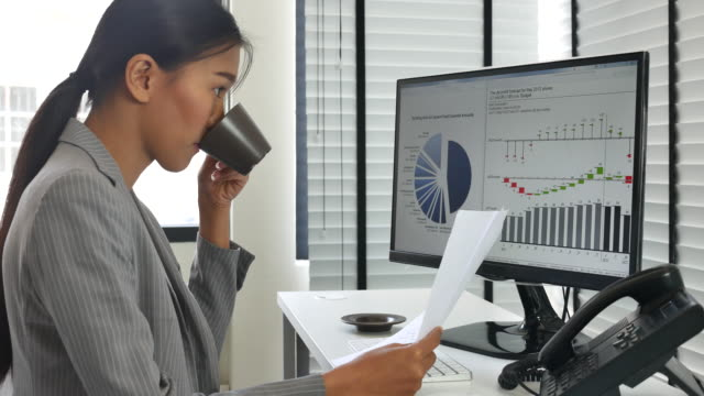 Asian Businesswoman Analyzing data for her business project