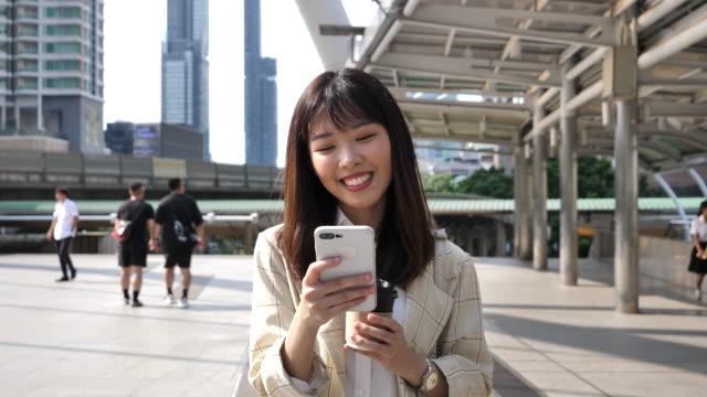asian businesswoman commuting to work - door to door salesperson stock videos & royalty-free footage