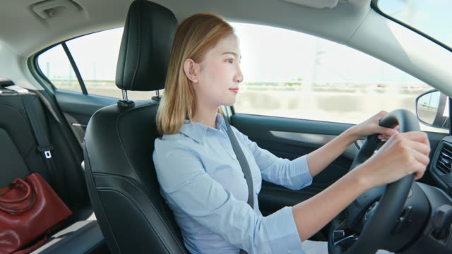 asian businesswoman driving car - korean ethnicity stock videos & royalty-free footage