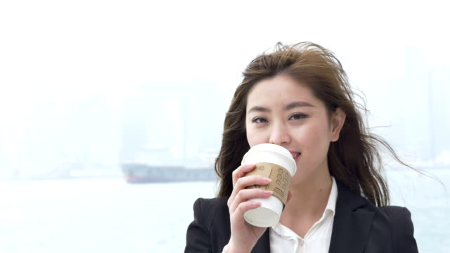 Asian Businesswoman enjoy coffee outdoor in Hongkong.