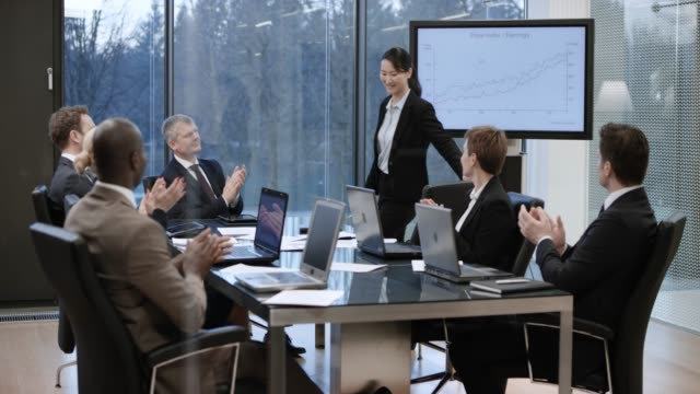 asian businesswoman receiving an applause after her presentation in the meeting room - flat screen stock videos & royalty-free footage
