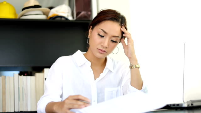 asian businesswoman serious about the work done until the headache,soft focus - headache stock videos & royalty-free footage
