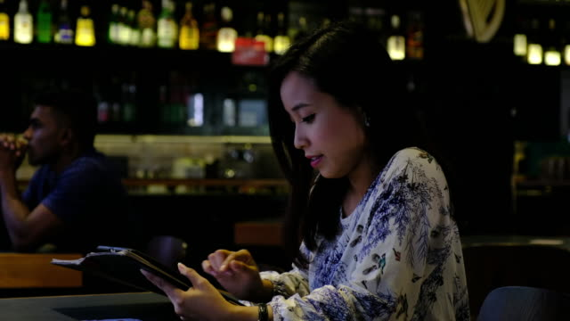 asian businesswoman sitting working and having a drink - coffee drink stock videos & royalty-free footage