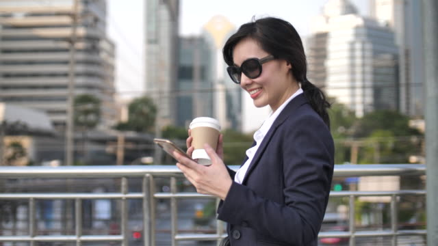 asian businesswoman texting message to her client - beautiful people stock videos & royalty-free footage