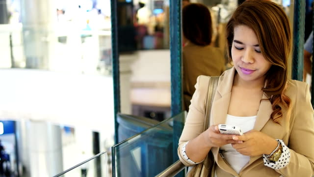 asian businesswoman touching mobile phone - hot desking stock videos & royalty-free footage