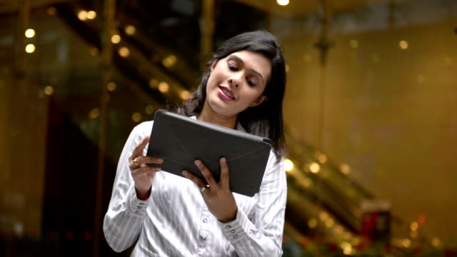 Asian Businesswoman using digital tablet