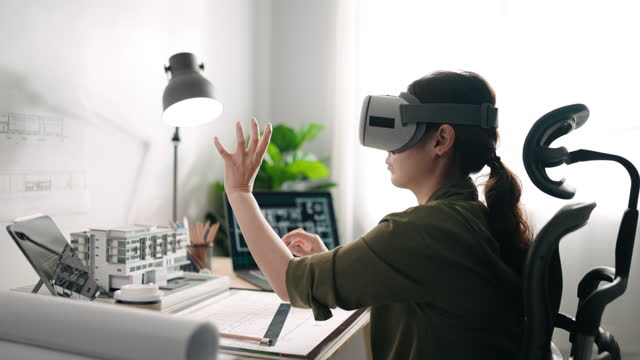 asian businesswoman using vr glasses for her architect work at desk in office - cyberspace stock videos & royalty-free footage