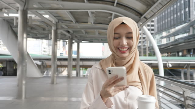 asian businesswoman wearing hijab commuter to work - coffee drink stock videos & royalty-free footage