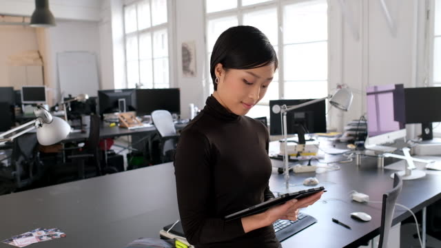 asian businesswoman with a digital tablet in office - only japanese stock videos & royalty-free footage