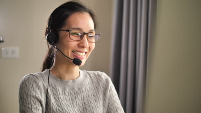 asian call center support her customer at home - home office stock videos & royalty-free footage